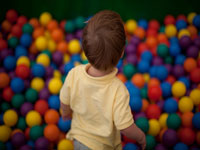 Child in ball pool © Larsz
