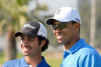 Othman Almulla and Tiger Woods at Dubai Desert Classic.